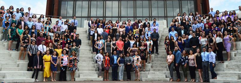 Photo of the participating graduate in the 2018 Latino Congratulatory ceremony. Photo shows three groups of people in posed lines on a set of steps.