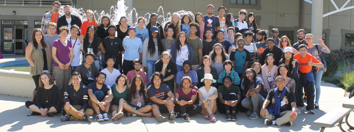 Photo of retreat participants posing in front of a fountain.